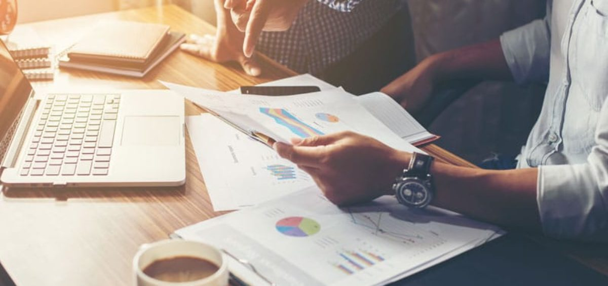 looking over documents   The Importance of Bookkeeping for a Growing Business